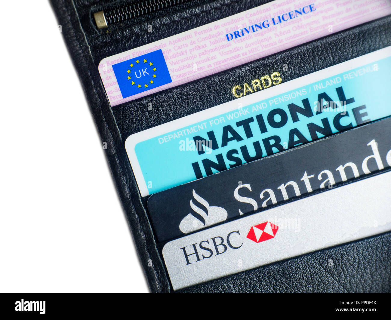 Assorted plastic cards filed in a black leather wallet - Stock Image