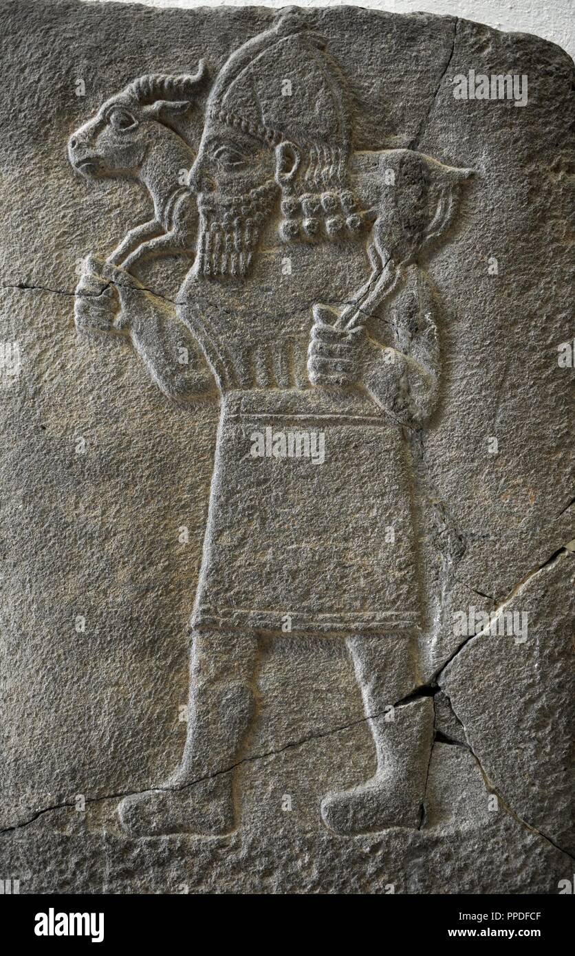 Hittite art. Orthostat. 8th century BC. Relief: Man carrying a gazelle.  Found in old city of Sma'al /Zincirli (Turkey). 775 BC. Pergamon Museum. Museum Island. Berlin. Germany. Stock Photo