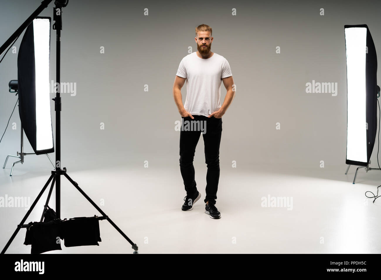 backstage self-confident man equipment workplace photo studio concept. Photography of fashion look - Stock Image