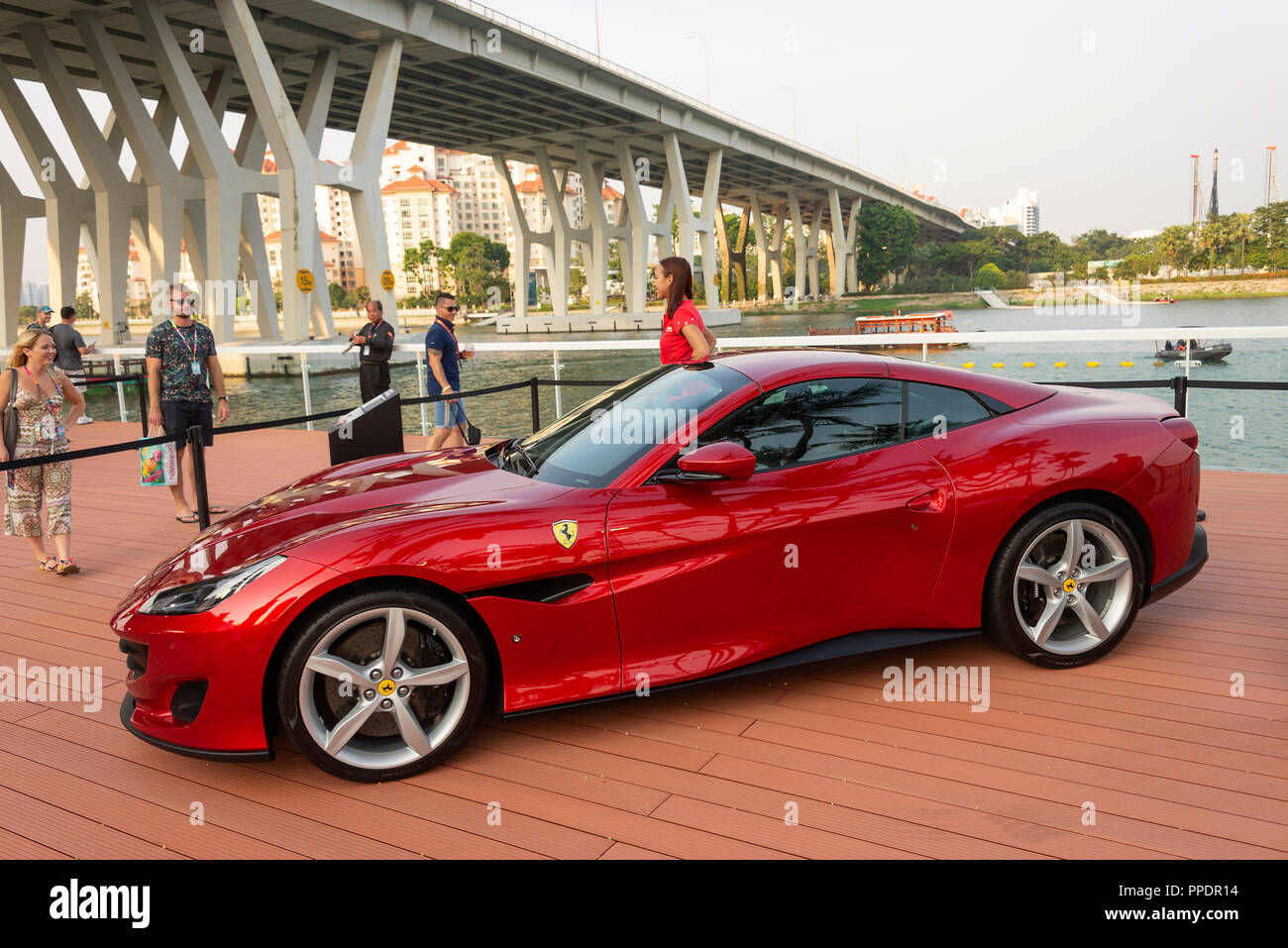 Ferrari Portofino Luxury Drop-Top Sports Car on Display with Attractive Model at F1 Grand Prix at Marina Bay Singapore Asia - Stock Image