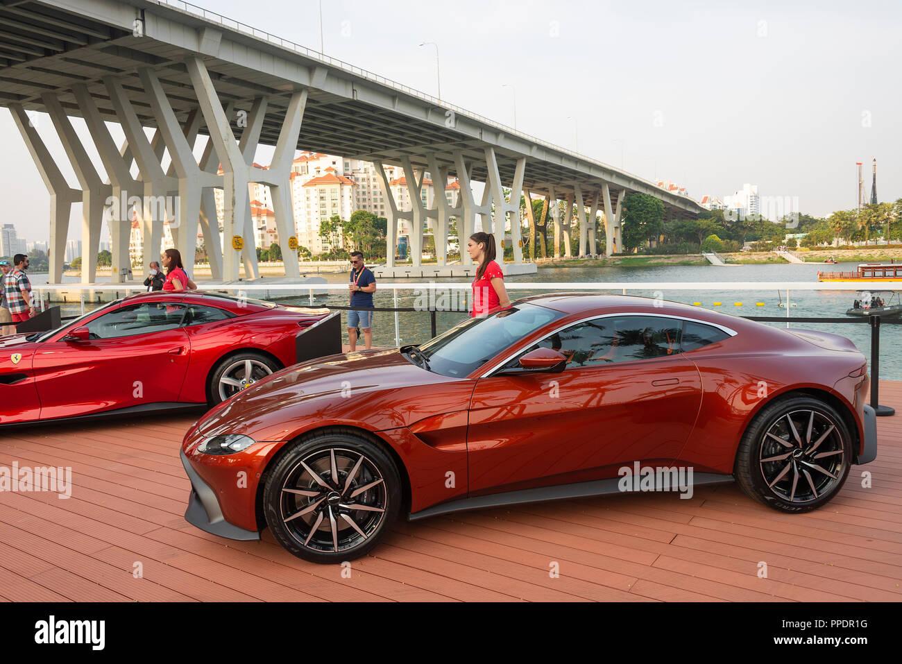 Ferrari Portofino And Aston Martin Vantage Luxury Cars On Display With Attractive Models At F1 Grand Prix At Marina Bay Singapore Asia Stock Photo Alamy
