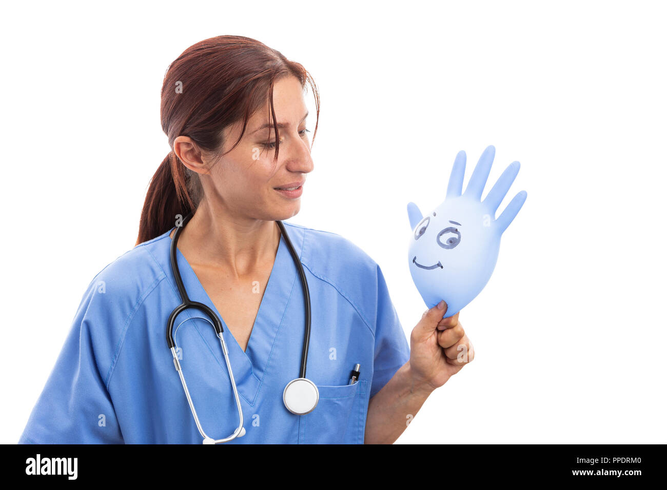 Friendly female pediatrician nurse looking at smiling latex glove isolated on white background - Stock Image