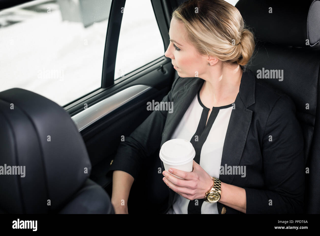 Young businesswoman travelling in the car - Stock Image