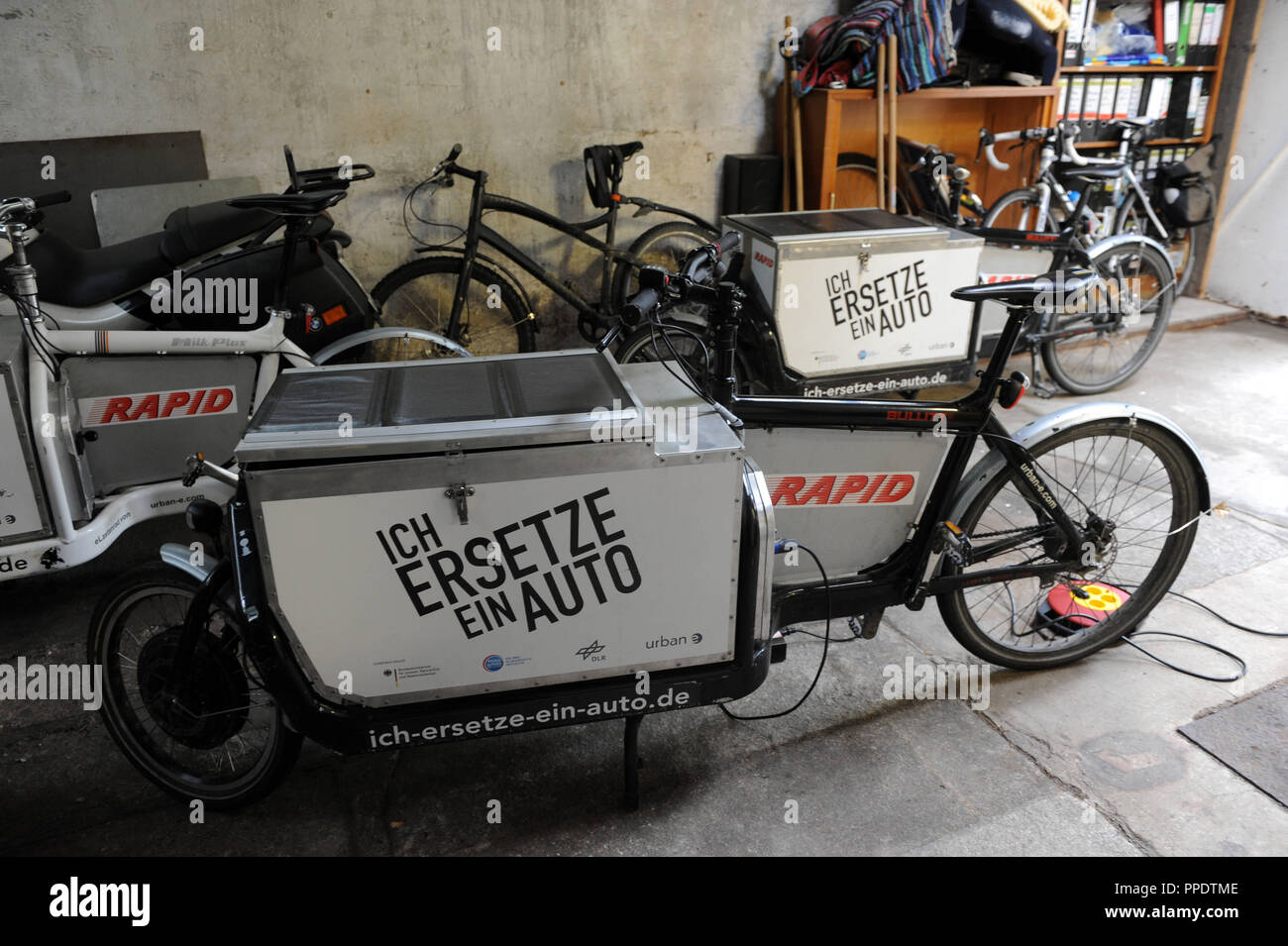 An electric cargo bike of the type bullitt in the premises of the courier