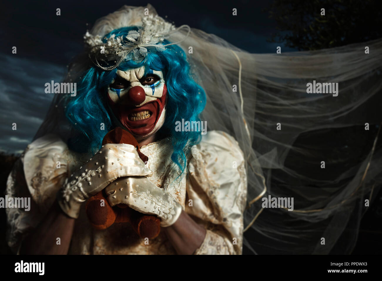 Closeup Of A Scary Evil Clown Wearing A Dirty And Ragged Bride Dress
