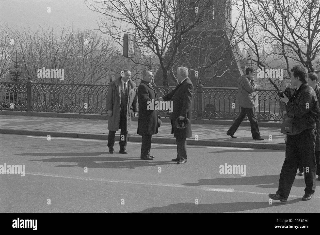 Moscow, Russia - March 28, 1991: Chairman of the Presidium of the Supreme Soviet of the Russian SFSR Boris Nikolayevich Yeltsin greets unknown person outdoors in Kremlin during 3d extraordinary Congress of people's deputies of russian RSFSR. - Stock Image