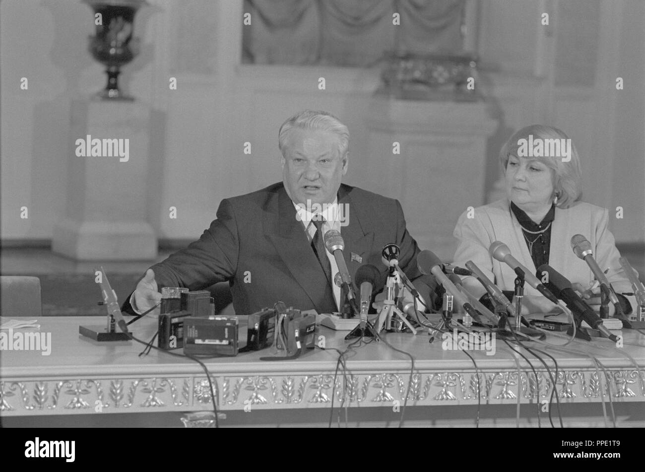 Moscow, Russia - March 28, 1991: Chairman of the Presidium of the Supreme Soviet of the Russian SFSR Boris Nikolayevich Yeltsin gives press conference at 3d extraordinary Congress of people's deputies of russian RSFSR. On the right his first press-secretary Valentina Alekseevna Lantseva. - Stock Image
