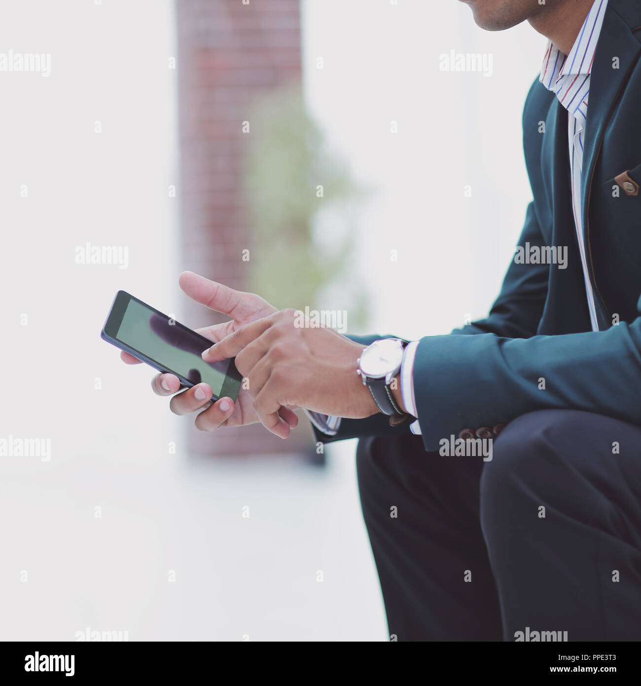 closeup. employee typing SMS on the smartphone - Stock Image