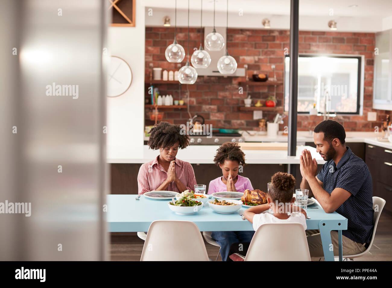 family praying around table - HD1300×956