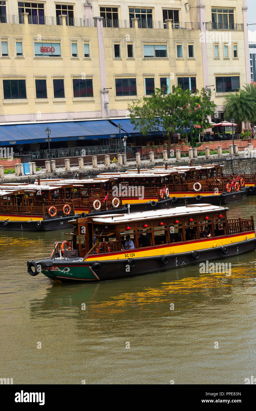 The Riverside Point Shopping Mall with Shops Bars and Restaurants  near Clarke Quay in Downtown Singapore with Taxi Boats on Singapore River Stock Photo