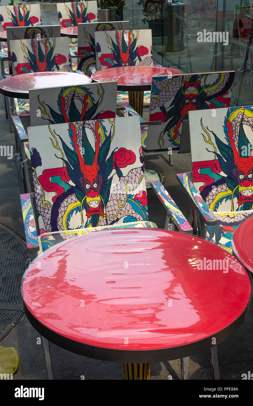 Colourful Tables Outside the Spiceworld Hot Spot Restaurant Serving Asian Food in Clarke Quay Downtown Singapore Republic of Singapore Asia - Stock Image