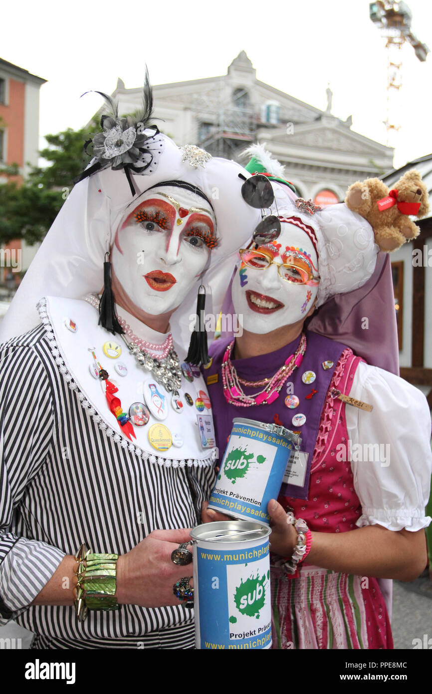 """Costumed people raising funds at the Gaertnerplatzfest for the gay cultural center """"Sub"""". Stock Photo"""
