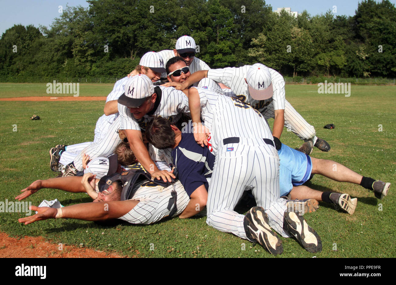 Exultation at the baseball regional league team Munich Caribes after the match against the Gauting Indians. The Caribes won with 5:3 and 7:1 and thus secured the Regionalliga Championship and promotion to the 2nd Bundesliga. - Stock Image