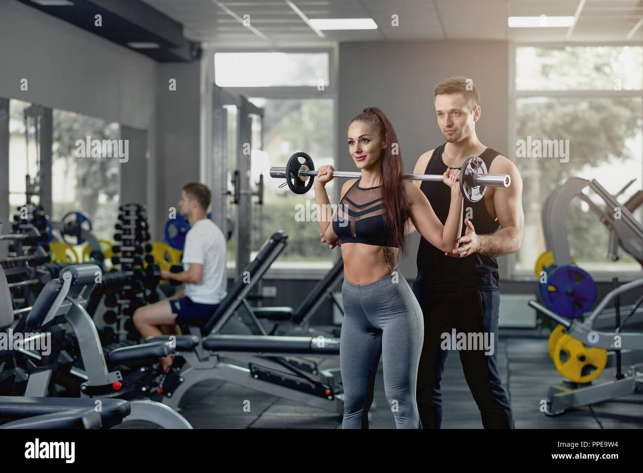 Handsome Male Personal Trainer Supporting Muscular Woman -6578