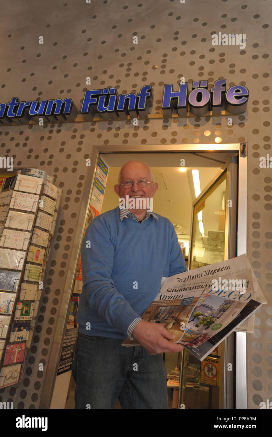 "Wolfgang Baer in his newspaper and magazine shop ""Pressezentrum Fuenf Hoefe"" in the Pranner Passage in Munich... Stock Photo"