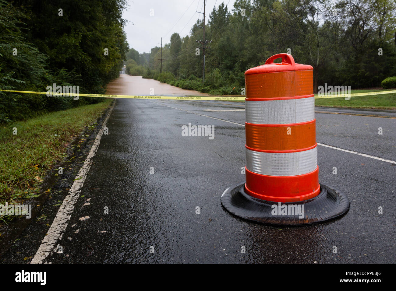Waxhaw, North Carolina - September 16, 2018: Police barricade the road after a bridge is washed out by rain from Hurricane Florence - Stock Image