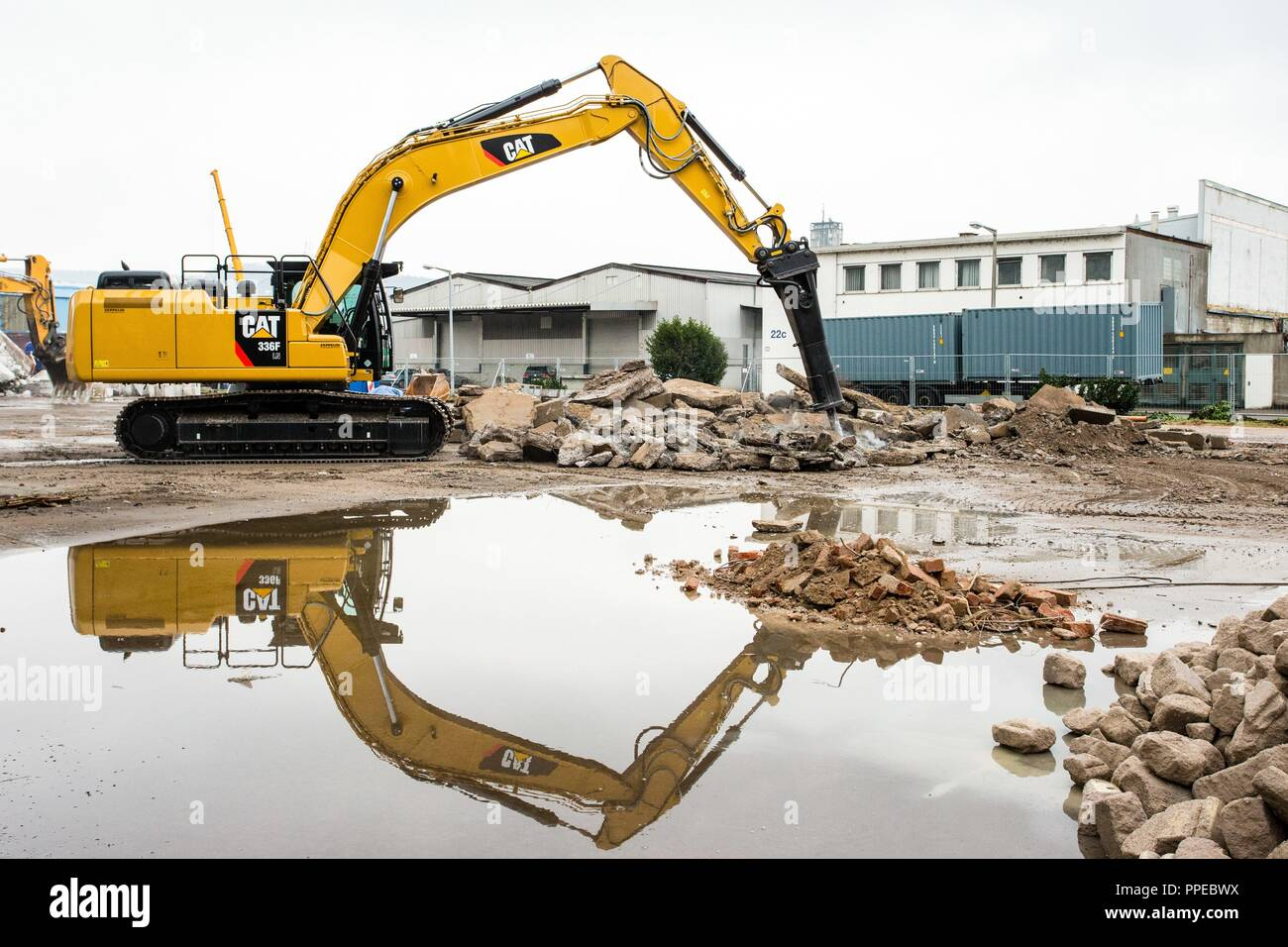 A brand new Caterpillar 336F LN excavator with hammer be
