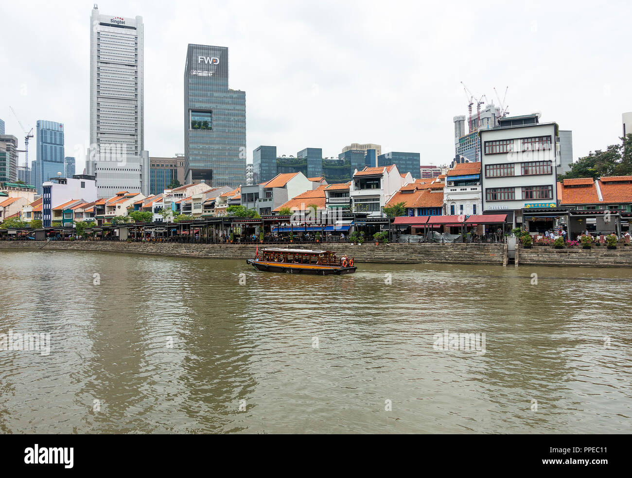 The Beautiful Boat Quay Housing Restaurants with Passenger Taxi Boat on Singapore River South Bank Singapore Stock Photo