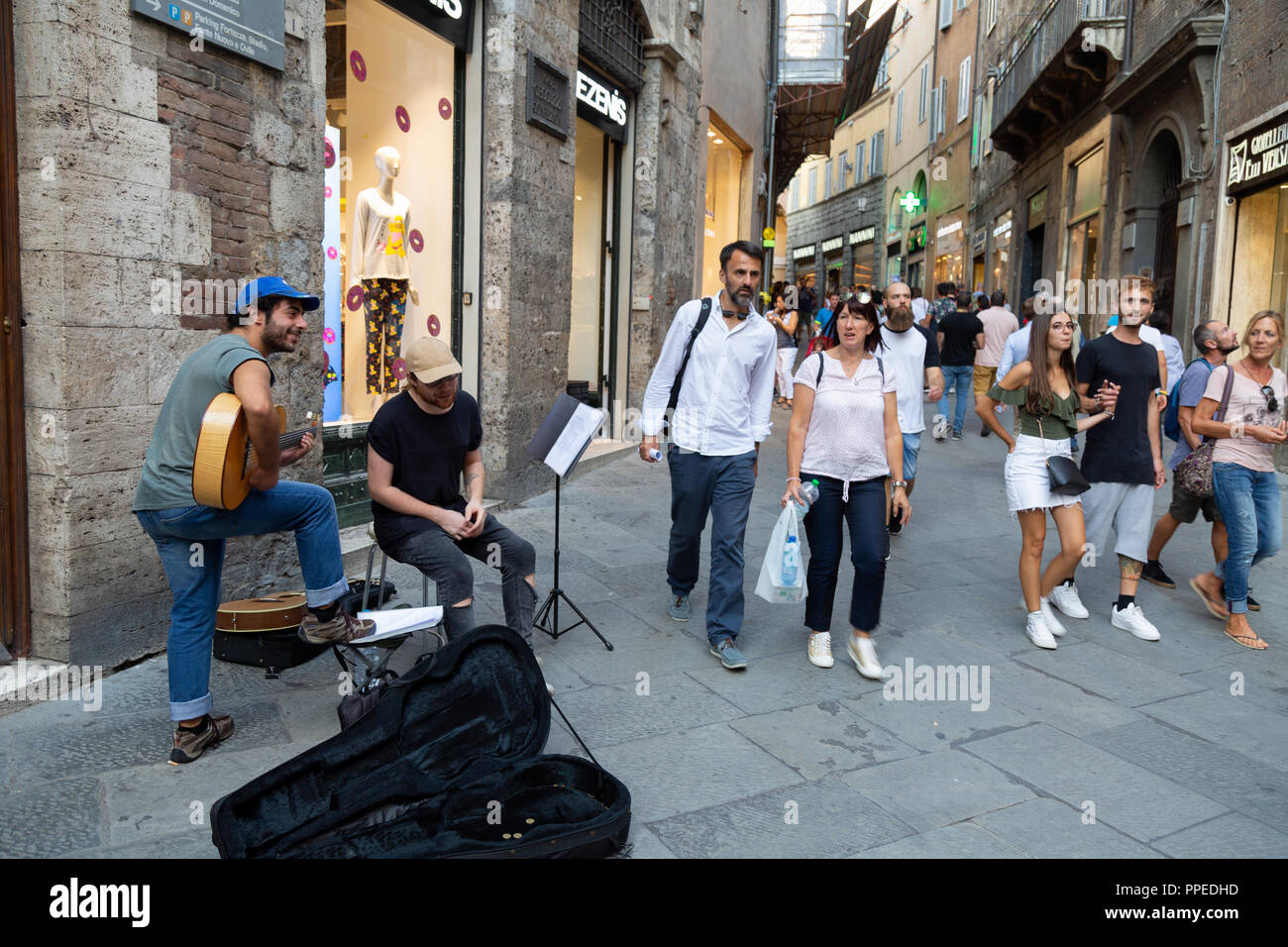 Two buskers busking on the street, Siena, Tuscany Italy Europe - Stock Image