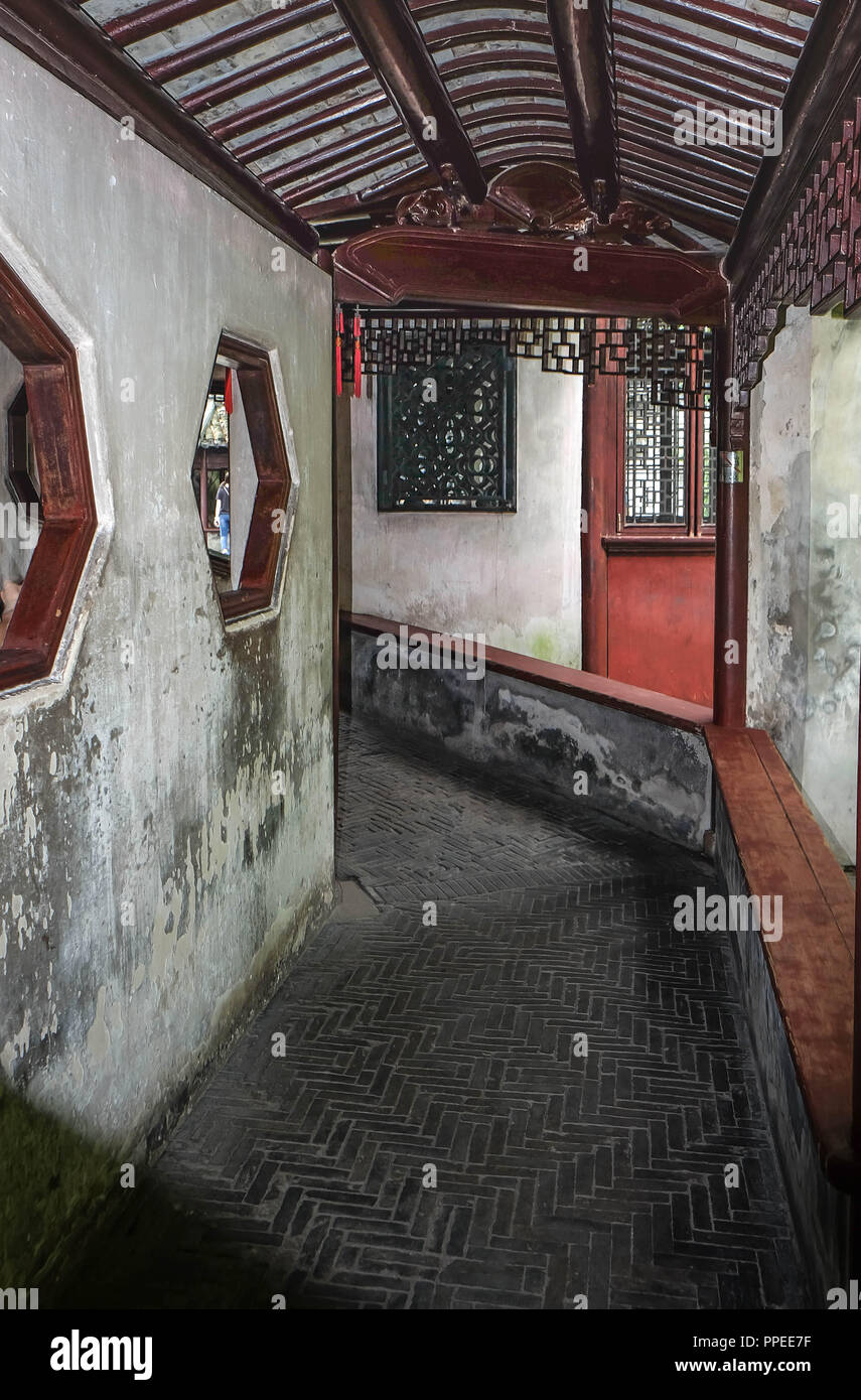 Narrow alley with antique brick walls,  building style in the Chinese area of Shanghai, China - Stock Image
