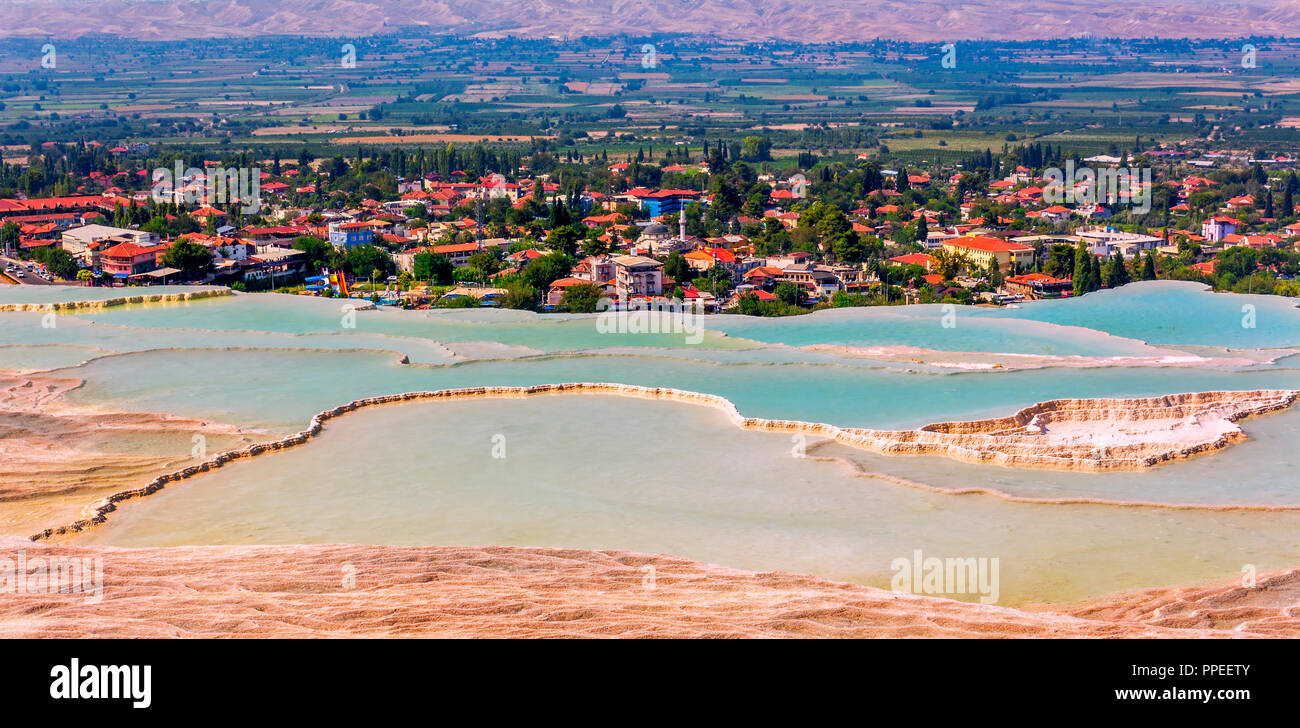 lake in Pamukkale with a view of the city on a sunny day - Stock Image