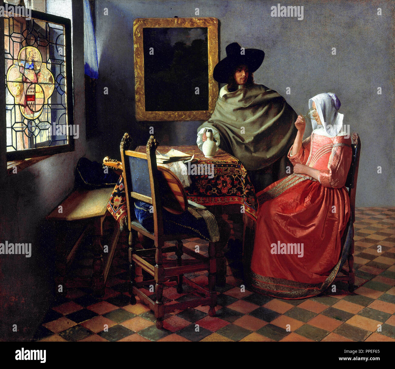 Johannes Vermeer - The Glass of Wine. Circa 1661. Oil on canvas. Gemaldegalerie Alte Meister, Dresden, Germany. - Stock Image