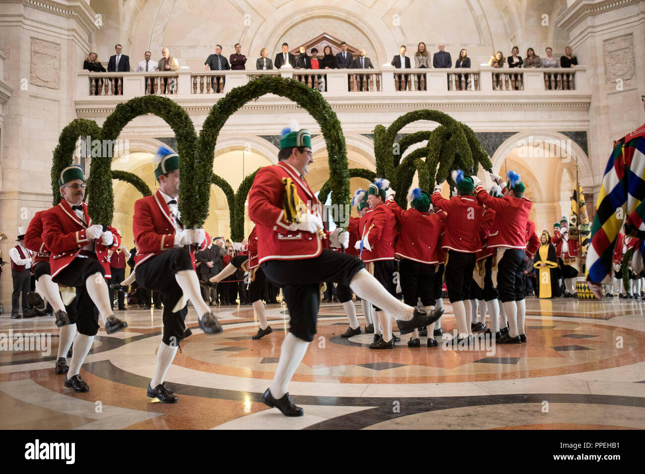 The Muenchner Schaeffler open the extraordinary season on the 500th birthday of the Schaefflertanz (Copper's Dance) with a dance interlude in the Kuppelsaal of the Bavarian State Chancellery. - Stock Image