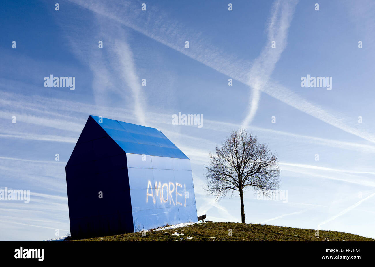 House model with the inscription 'Amore' as public art in a commercial area on the outskirts of Ravensburg. - Stock Image