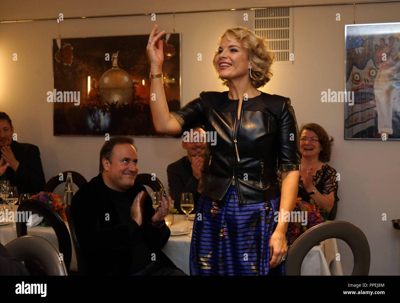 The Latvian mezzosoprano Elina Garanca celebrating in the hotel 'Bayerischer Hof' following the premiere of the Donezetti opera 'La Favorite' in the Bavarian State Opera. To her left is her husband, Karel Mark Chichon, who conducted the opera premiere. - Stock Image