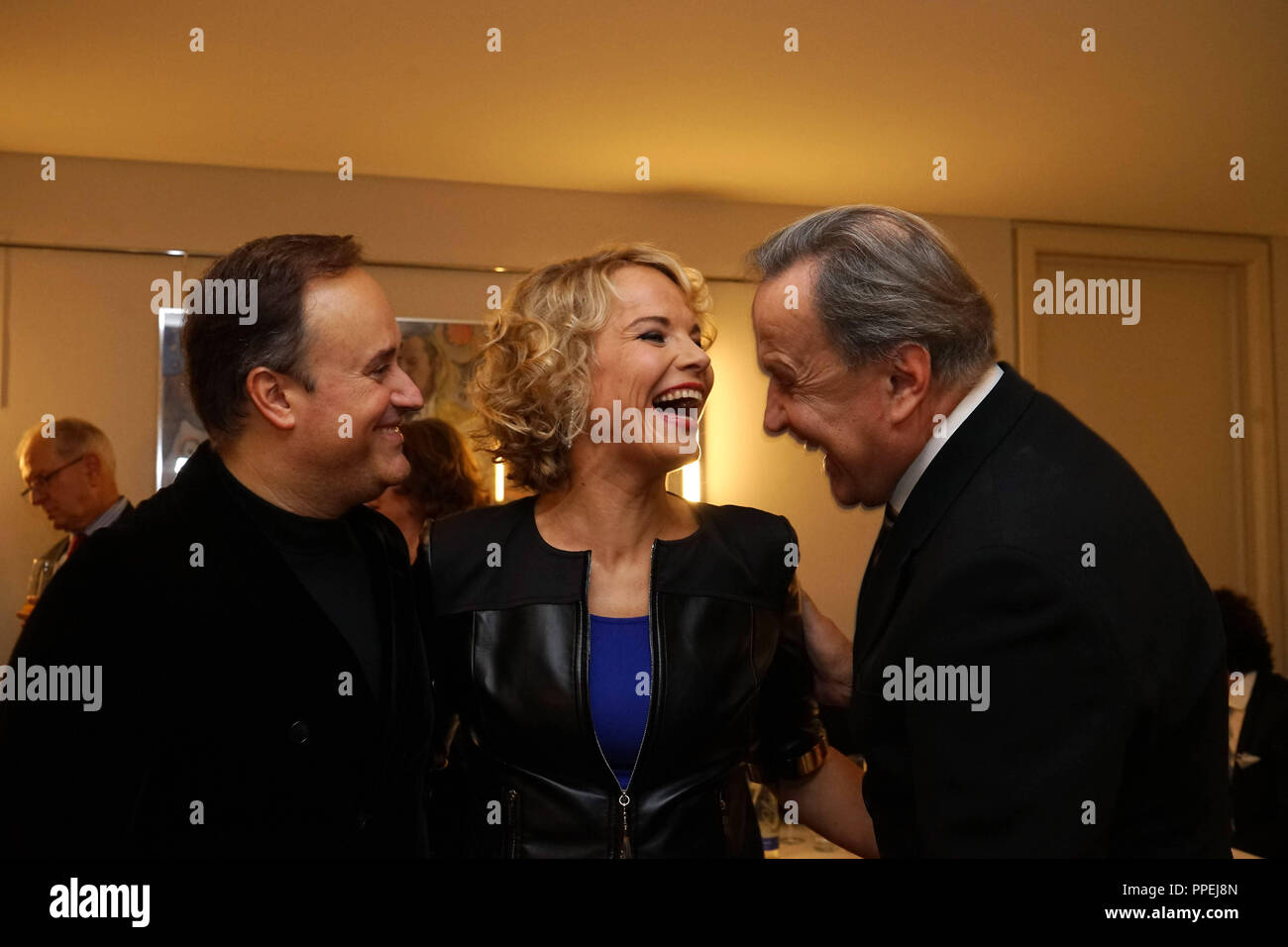 From left: conductor Karel Mark Chichon, the mezzo-soprano Elina Garanca and State Opera director Nikolaus Bachler celebrate in the hotel 'Bayerischer Hof' following the premiere of the Donezetti opera 'La Favorite' in the Bavarian State Opera. - Stock Image