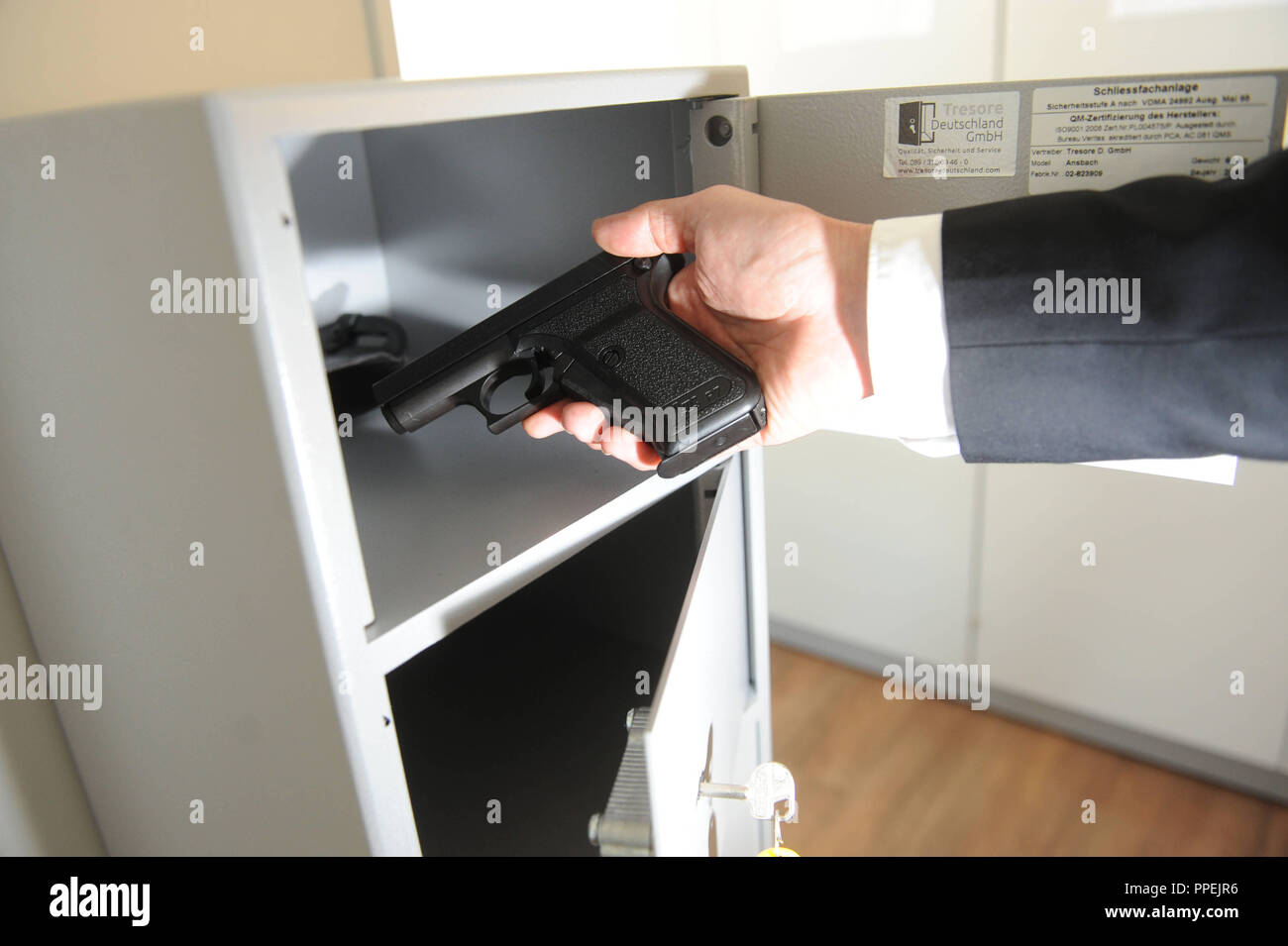 """Prior to a meeting in the office """"Internal investigations"""" in the Bavarian State Criminal Police Office (LKA) in Ridlerstrasse officials must hand off their service weapon. Stock Photo"""