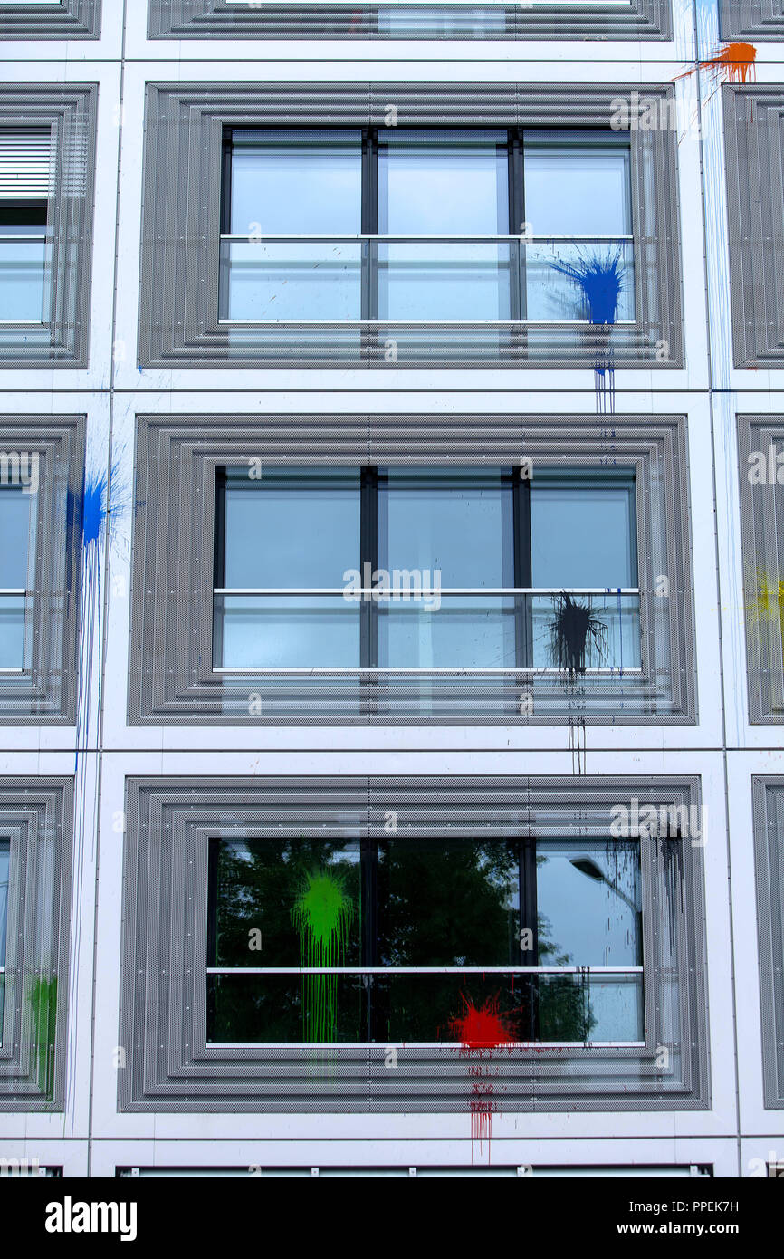 Autonomists have thrown paint bombs on the new building of the Glockenbach Suites at the Reichenbach Bridge. - Stock Image