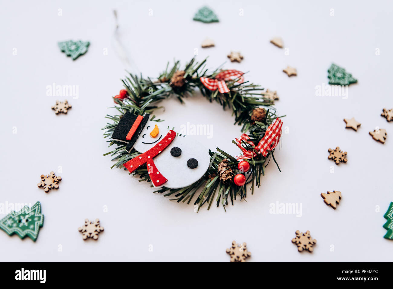 Christmas wreath with snowman Christmas tree toy on white background ...