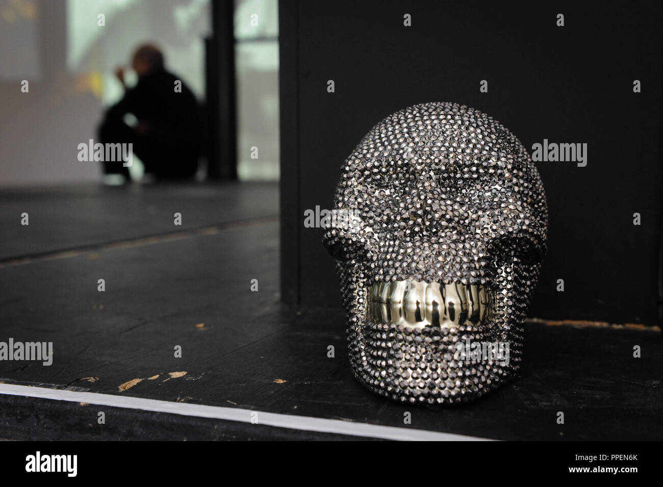 Skull with rhinestones in the current Hamlet exhibition at the Theatre Museum Munich in the Galeriestrasse 4a. - Stock Image