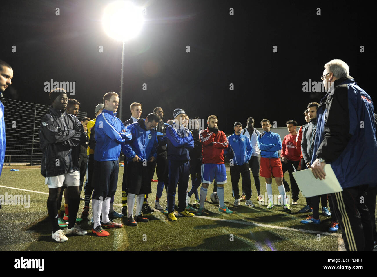 The Munich football club FC Wacker cares about the successful integration of migrants and asylum seekers in the image coach Bernd Klemm speaking to his players. - Stock Image