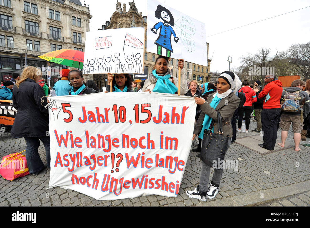 Refugee women demonstrate in Munich against the Lagerpflicht (the law that forces refugee women and children to live together in inhumane conditions in collective housing), as they are frequently victims of violence in communal accommodations. - Stock Image