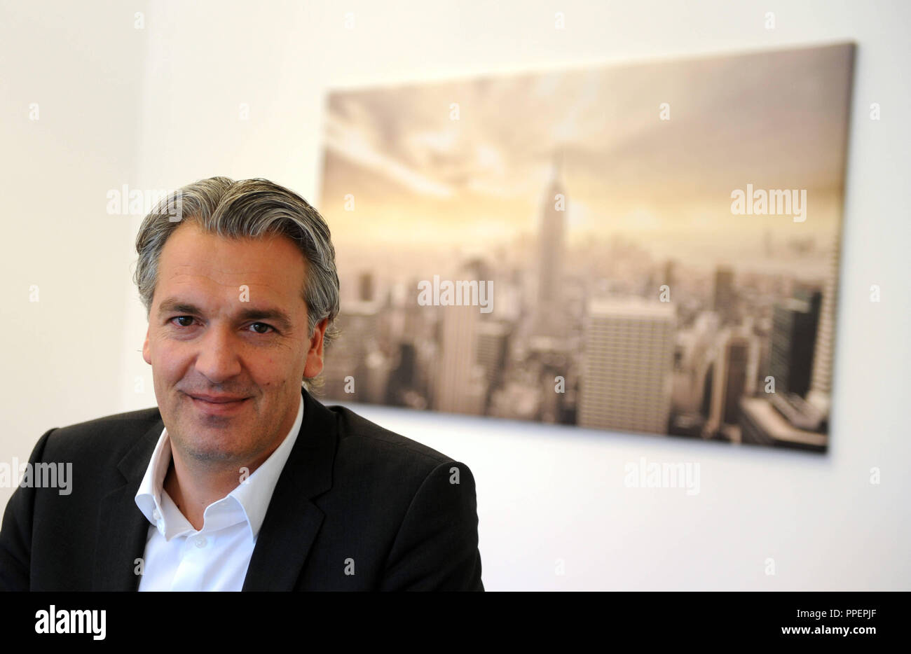 Director of 'Internationalization and Strategy', Jörg Wacker at his office - Stock Image