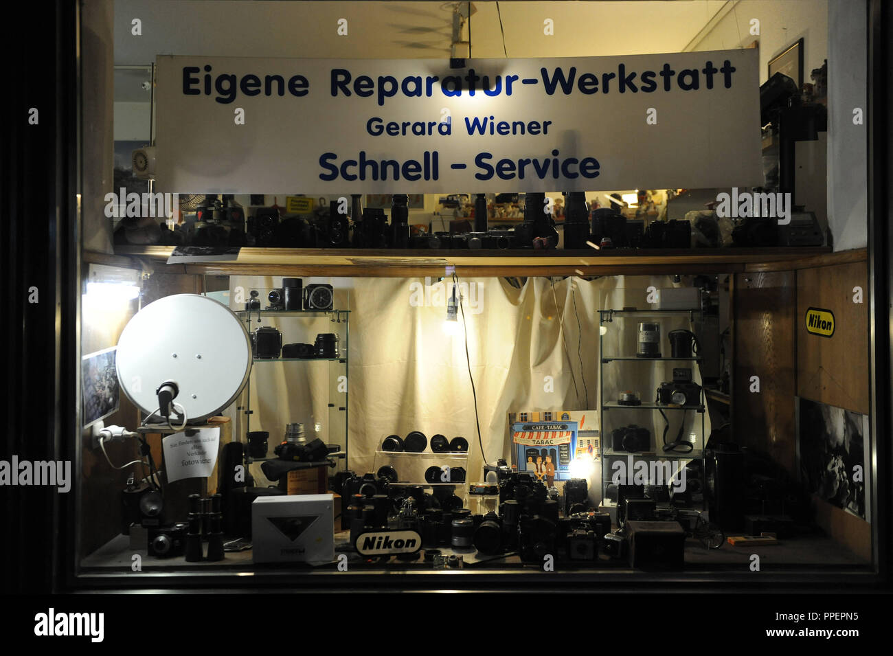 Precision engineer Gerard Wieners small business in the Landwehrstraße in which he repairs and solds analog cameras, Munich, Germany - Stock Image