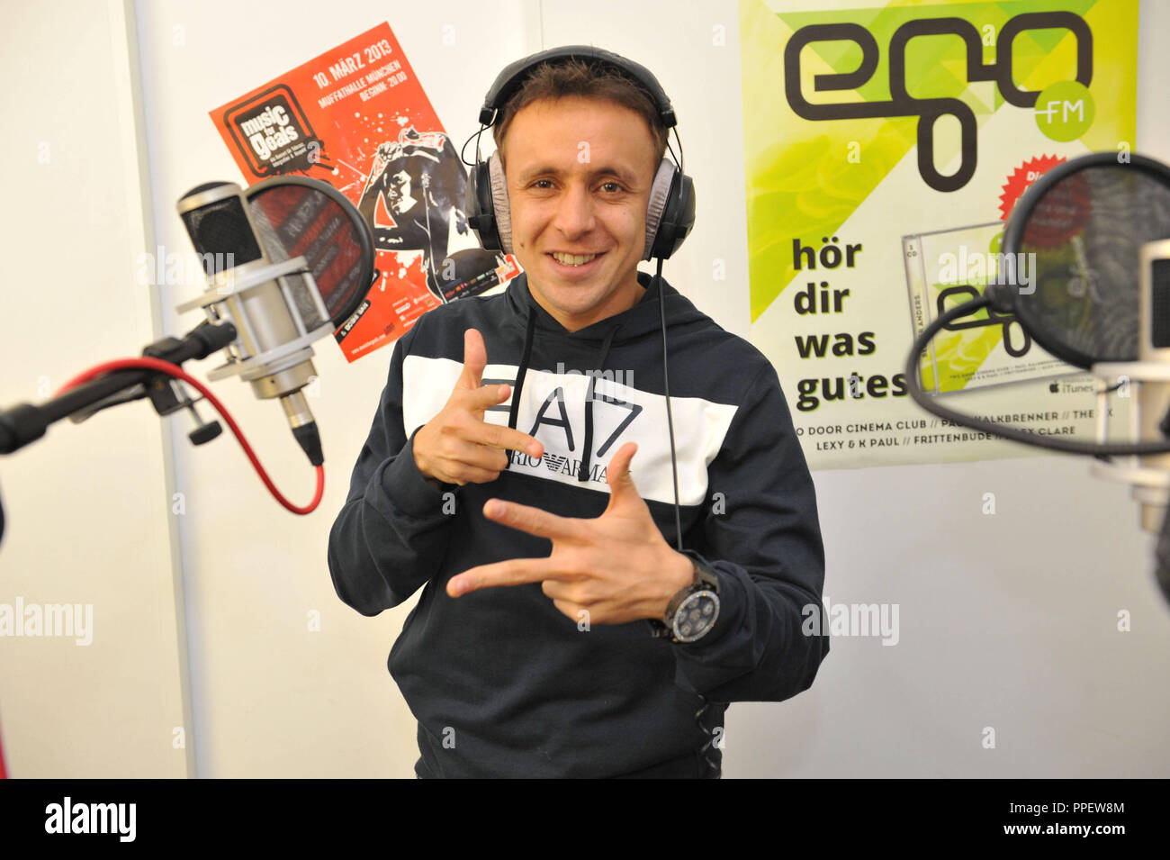 The Brazilian professional football player Rafinha from Bayern Munich advertises in a broadcast of Radio egoFM the concert project 'Music for Goals', which turns against racism, xenophobia and violence in society. - Stock Image