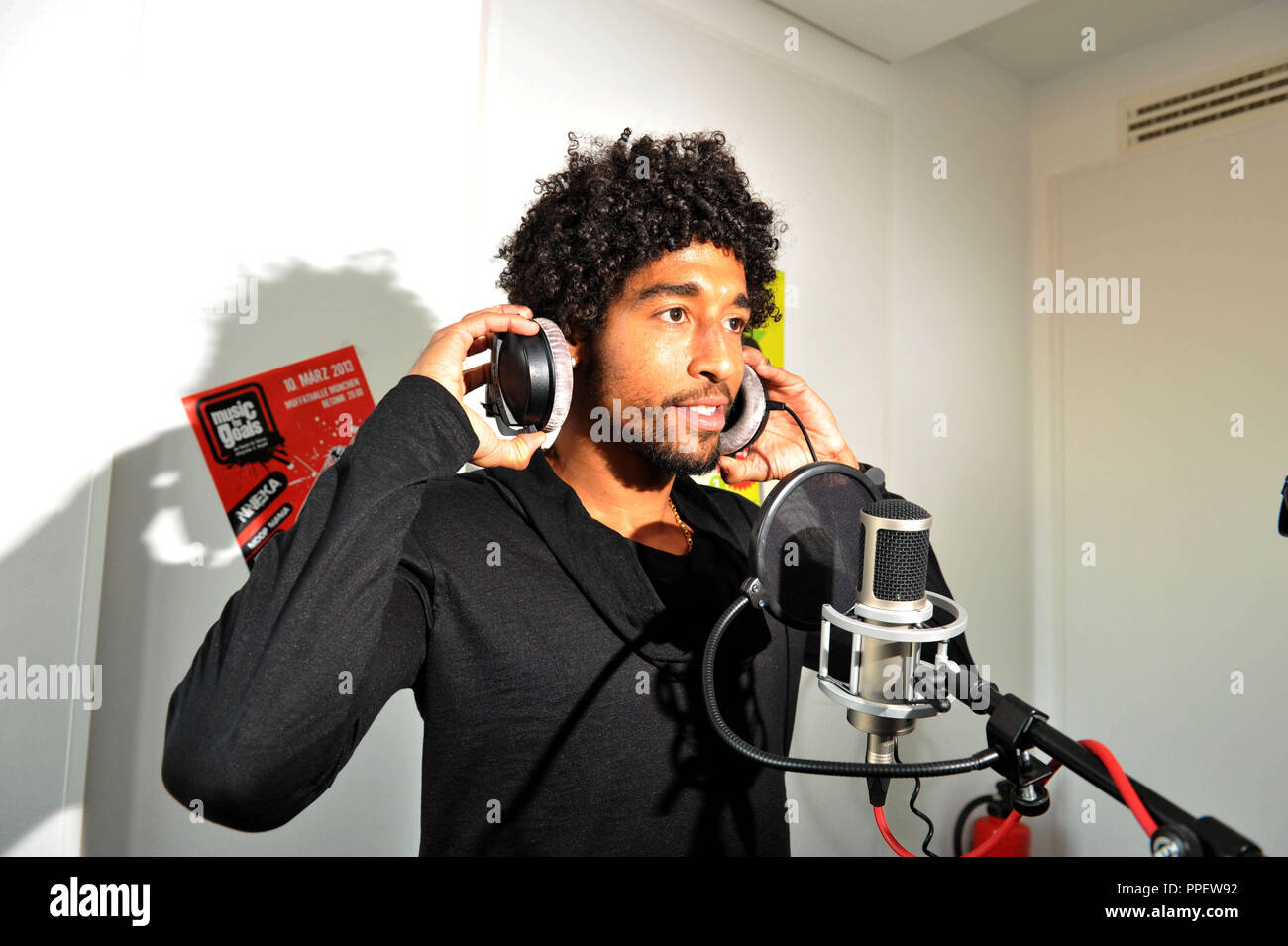 The Brazilian professional football player Dante from Bayern Munich advertises in a broadcast of Radio egoFM the concert project 'Music for Goals', which turns against racism, xenophobia and violence in society. - Stock Image