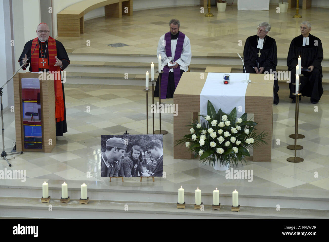 To commemorate the resistance fighter Sophie Scholl who was assassinated 70 years ago, Hans Scholl and Christoph Probst from the 'White Rose', the Archbishop of Munich and Freising, Cardinal Reinhard Marx (left), and the Bishop of the Evangelical Lutheran Church in Bavaria, Heinrich Bedford-Strohm (2nd from right) celebrate a church service in the church on the grounds of the Stadelheim Prison. - Stock Image