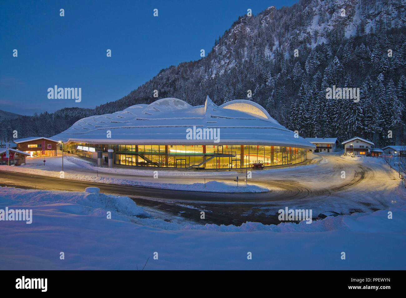 Ice stadium in Inzell at blue hour in the snowy winter - Chiemgau. - Stock Image