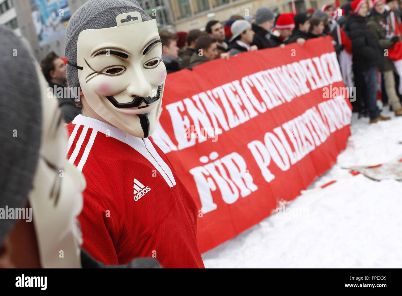 Football fans of FC Bayern Munich, Greuter Fuerth and TSV 1860 Muenchen demonstrate at the Munich Marienhof for the obligation of police officers in action to wear identifying badges. - Stock Image