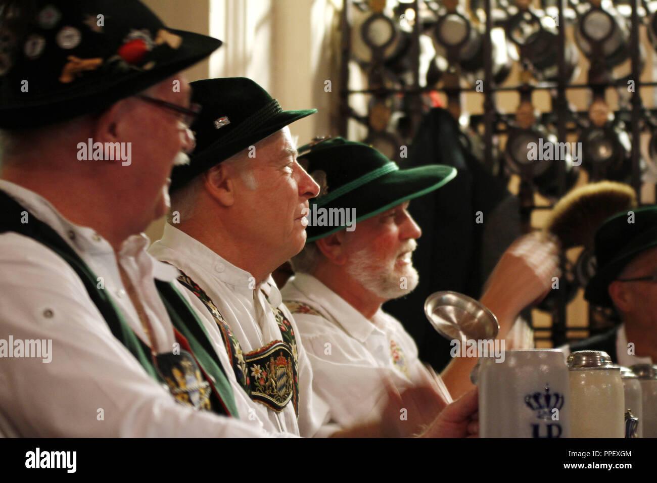 Men of the Stammtisch (regulars' table) 'Prinzregent' at the Hofbraeuhaus in good company. - Stock Image