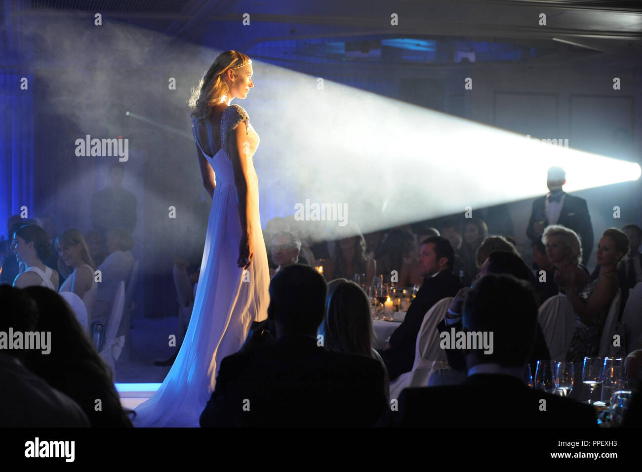 Start up party at the Hotel Vier Jahreszeiten. The new online fashion portal 'Dresscoded' is being presented by Natasha Gruen. Glamorous dresses can be rented on the site. - Stock Image