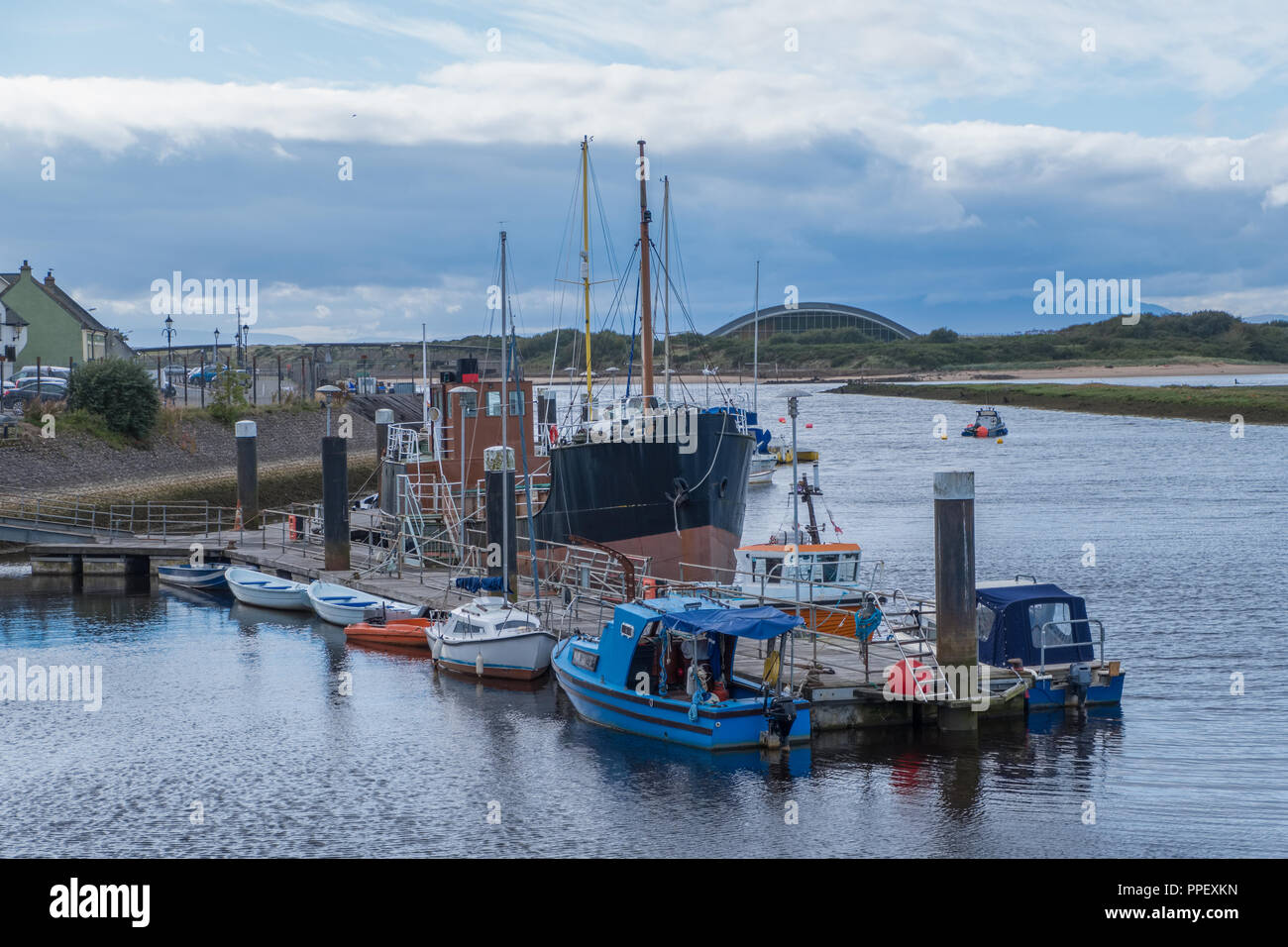 Fishing Trawler and some small craft moored at Irvine Harbour. Stock Photo