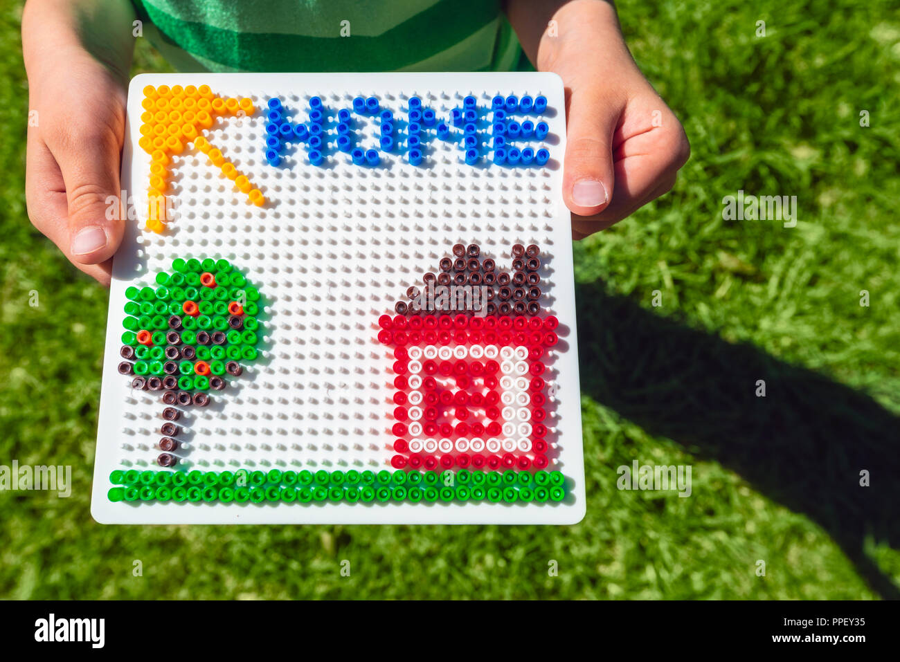 Home concept made from colorful plastic beads - Stock Image