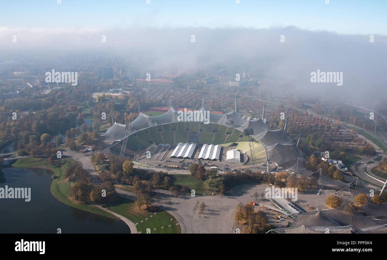 View of the Olympiastadion in the mist as seen from the Olympiaturm. - Stock Image