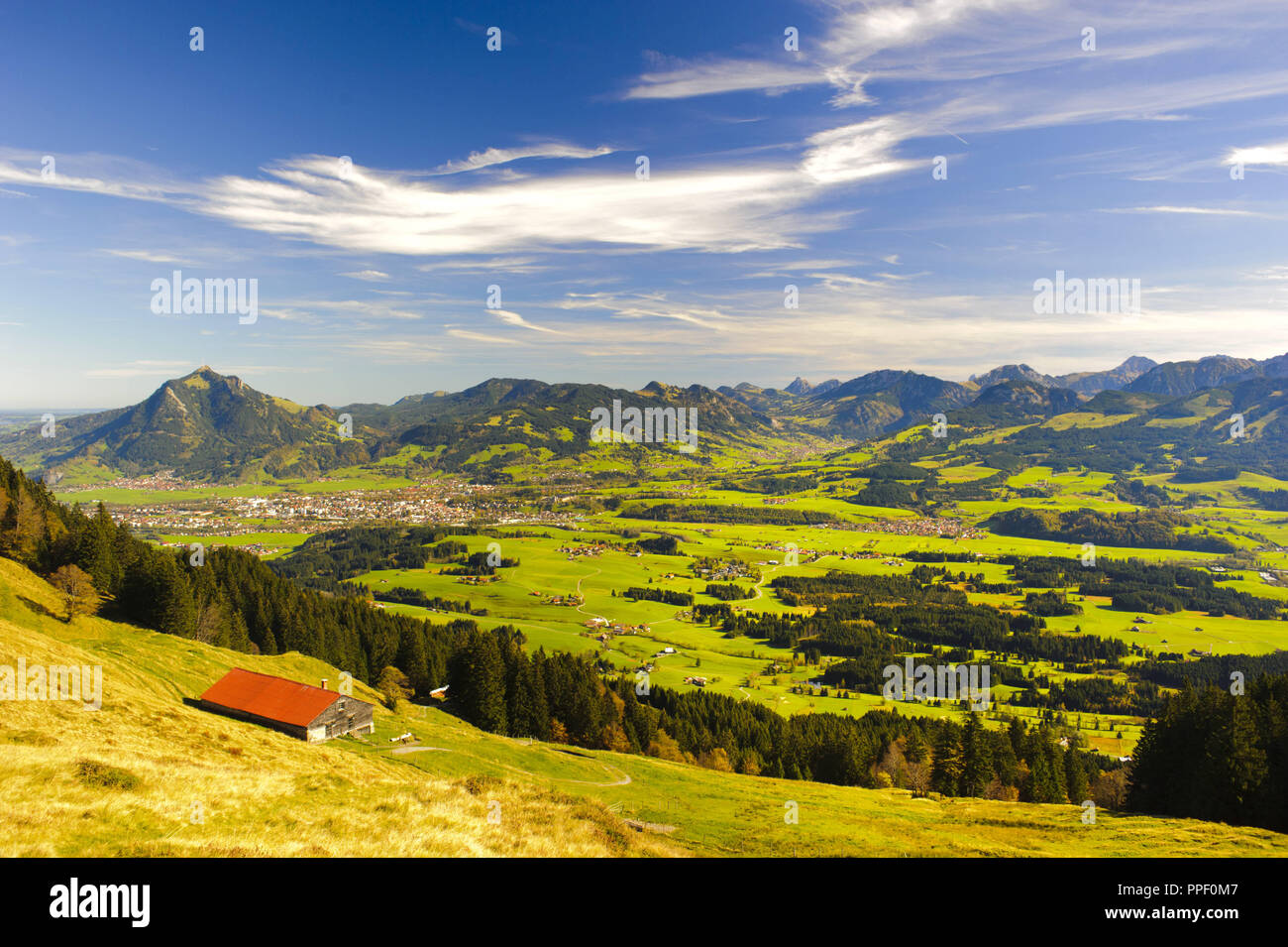 Panoramic landscape in Bavaria overlooking the Allgaeu and Sonthofen before the Gruenten mountain Stock Photo