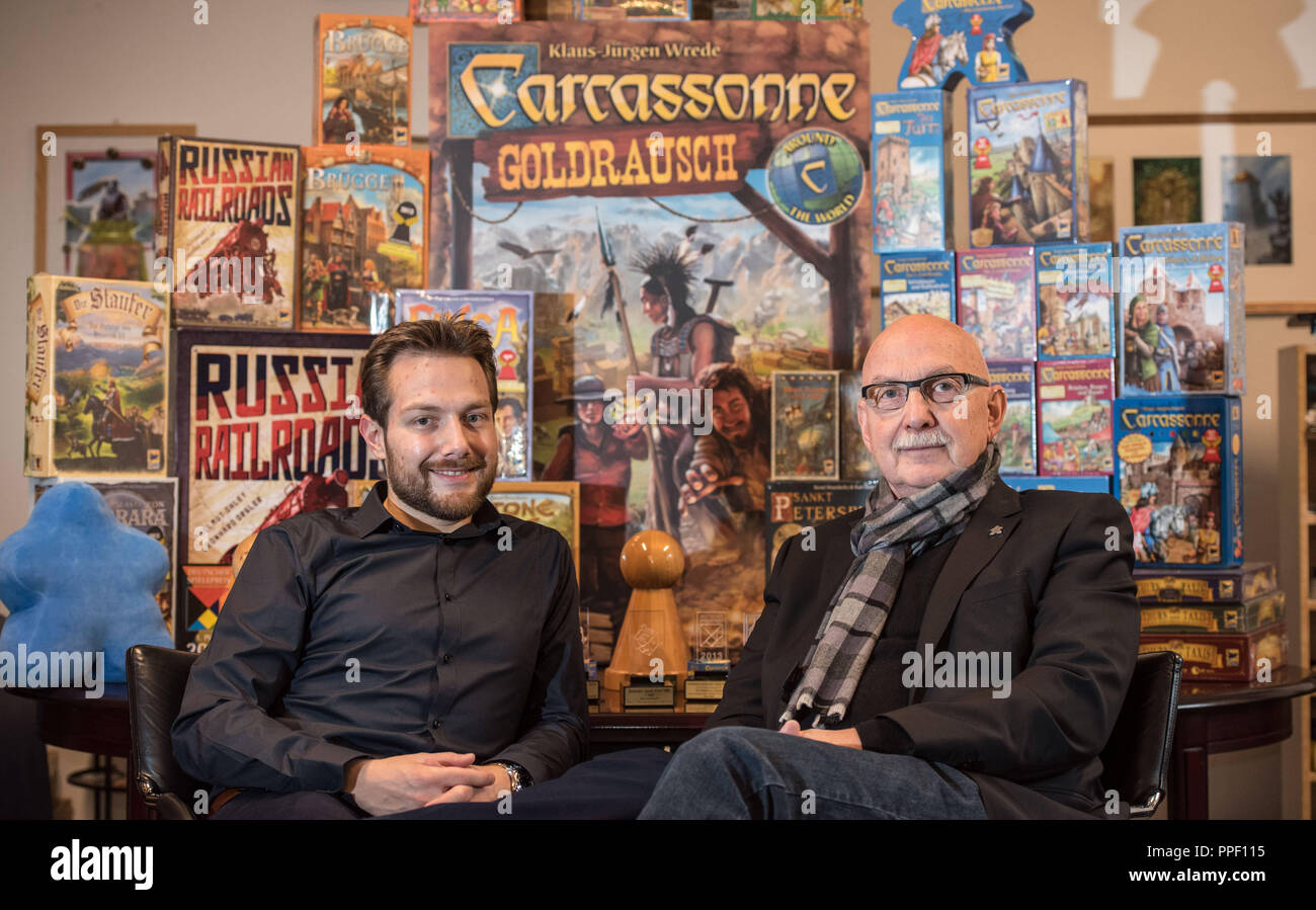 """Bernd Brunnhofer (l.) and son Moritz Brunnhofer, owner of the Munich games publisher """"Hans in Glueck"""", with their award-winning and multimillion-selling board game """"Carcassonne"""". Stock Photo"""